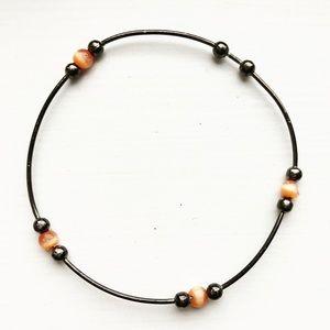 Boho wire & orange beaded bangle bracelet